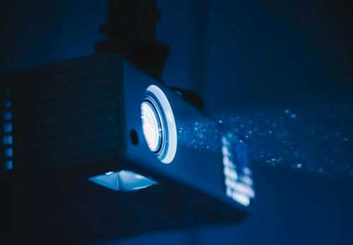 A projector shining in a dark room